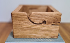 A custom-made yarn box in 20mm solid oak.  The yarn groove was hand cut and sanded up to 800 grit to avoid fibres catching as it fed out.