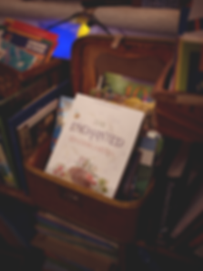 book-mockup-lying-with-other-books-in-a-