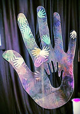 cdc_big hand with little ones in process