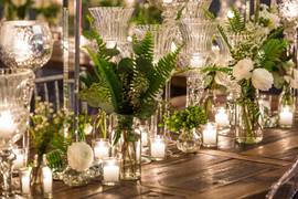 Seated Dinner Reception with Crystal Vases and Tropical Greenery
