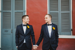 Two grooms pose in French Quarter