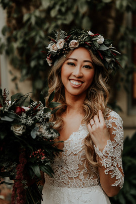 Gorgeous bride poses with flower crown and bouquet