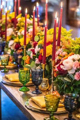Long head table with colorful center arrangement