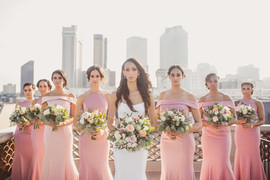 Bridal party looks stunning on balcony overlooking New Orleans