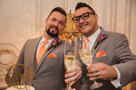 Two Grooms with Purple Boutonnieres
