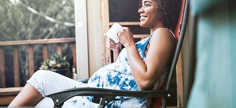 Pregnant Woman Enjoying her Drink