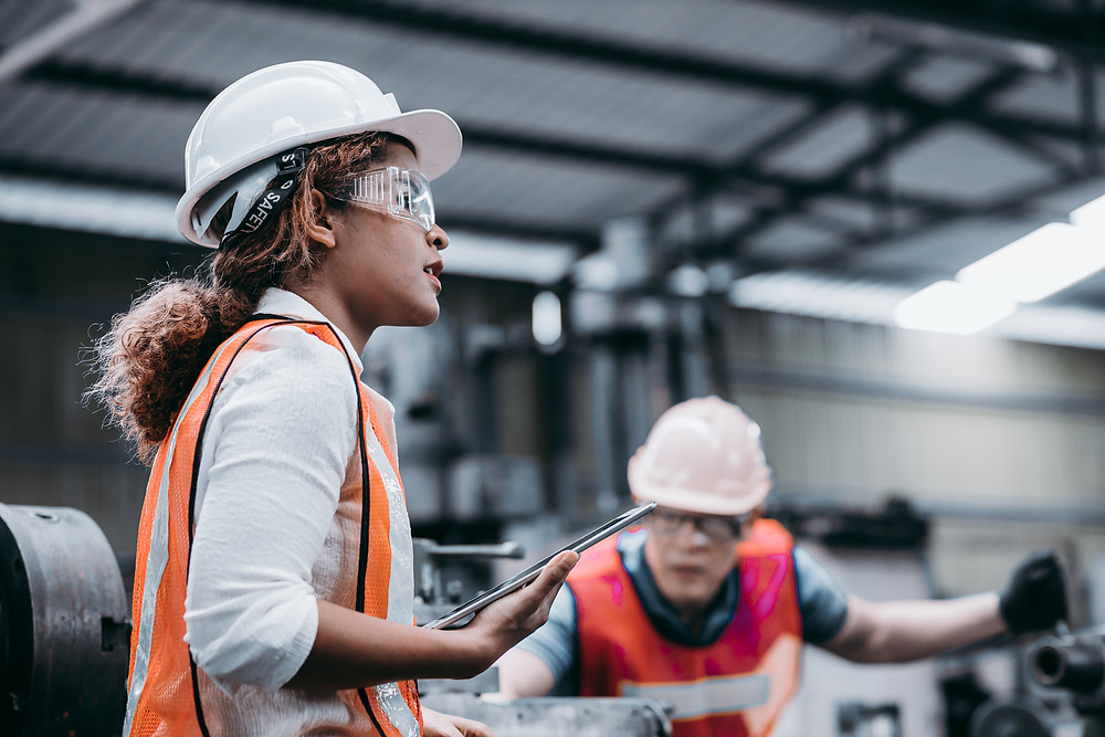 A woman engineer oversees a project in progress