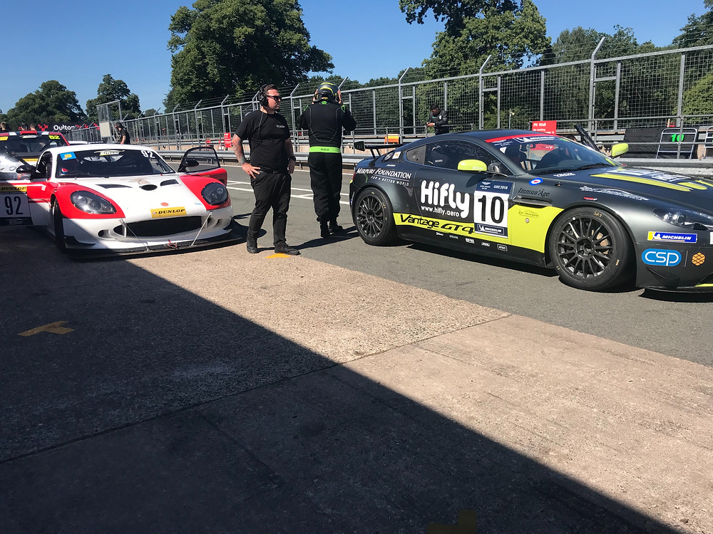 Both The Aston and Ginetta Waiting in the Pit Lane