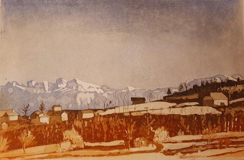 Vue du golf d'Esery sur les Alpes