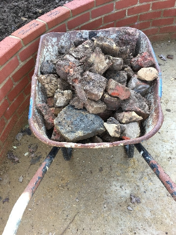 Clearing the soil - just one of many wheelbarrow-fulls!