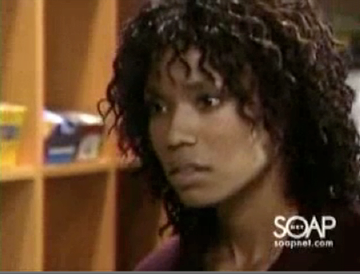 "Tia Dionne Hodge as ""Angel Mel"""