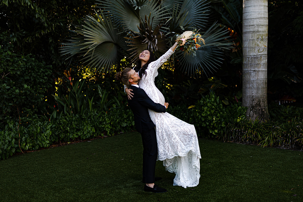 bride and groom lift pose