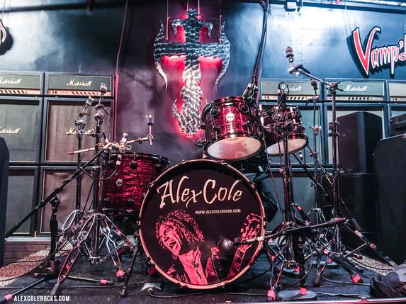 Alex Cole drum head branded.JPG