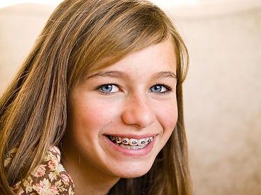 Blonde-girl-smiling-wearing-braces.jpg