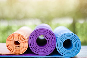 rolled-up-yoga-mats-exercise.jpg
