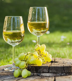 white-wine-with-grapes-on-old-wooden-tab