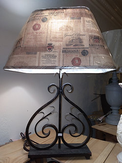 A Homestead Shopped Wrought Iron Lamp
