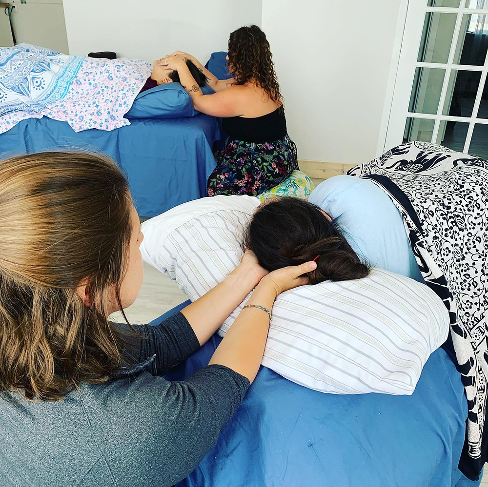 By the Moon students practice Reiki techniques for clients with infertility