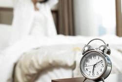 Why do I wake up before my alarm?
