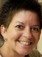 Kathleen Walsh                           Vice President & Administrative Director