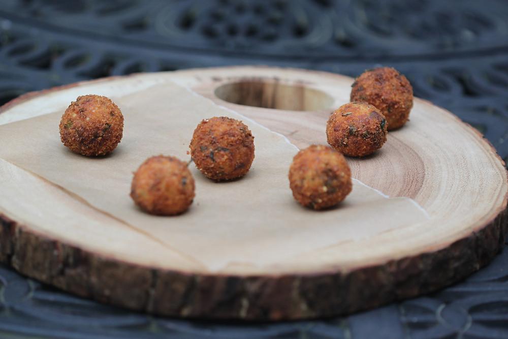 Quinoa balls served on a wooden platter