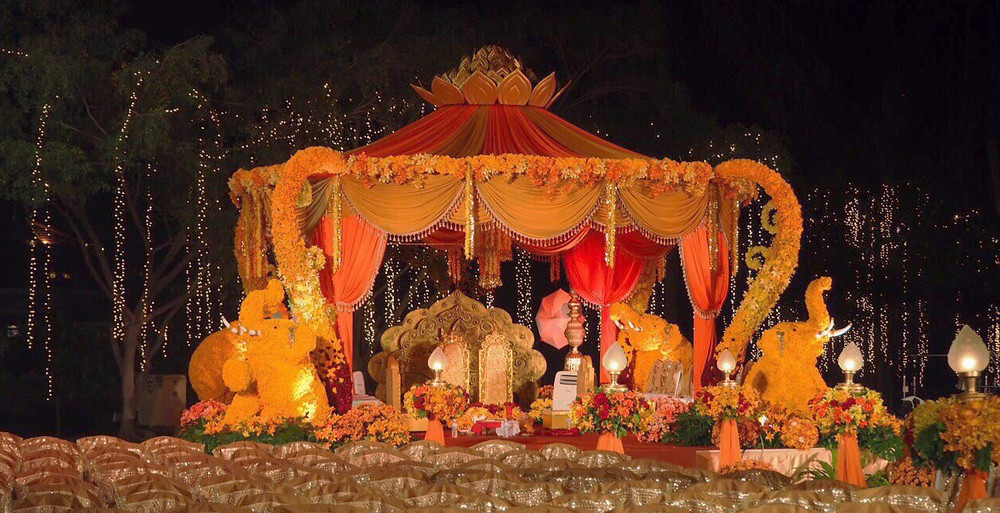 "Elephants made with flowers surround the wedding ""mandap"""
