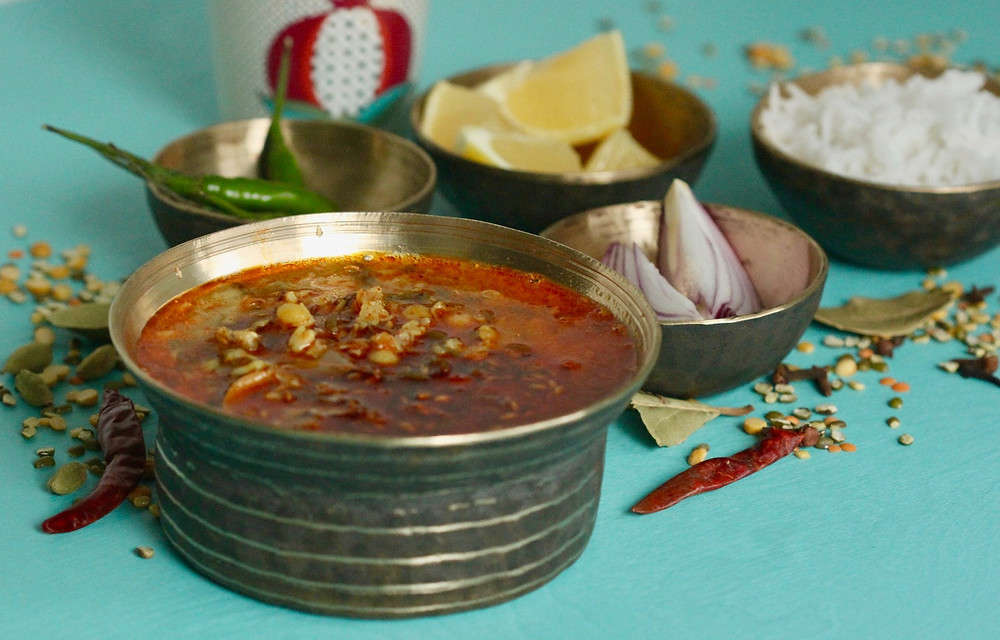 Rajasthani Panchmel Dal with lemon, green chillies, and red onions as condiments