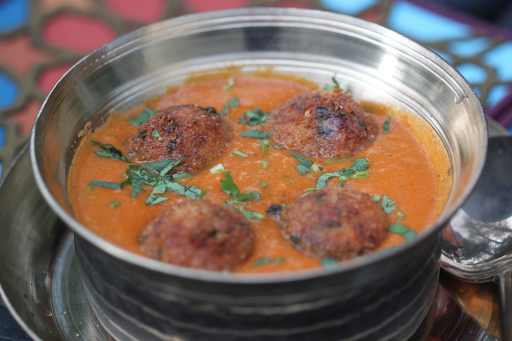The softest Quinoa Koftas in a tomato gravy
