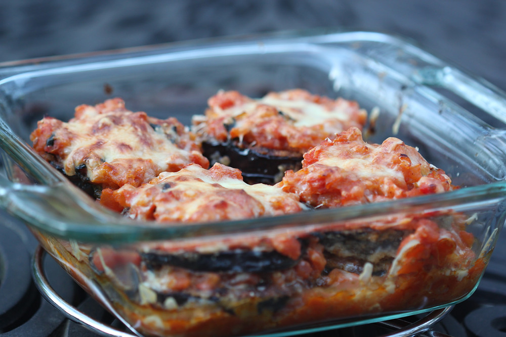 Simple yummy eggplant parmesan layered in a baking dish