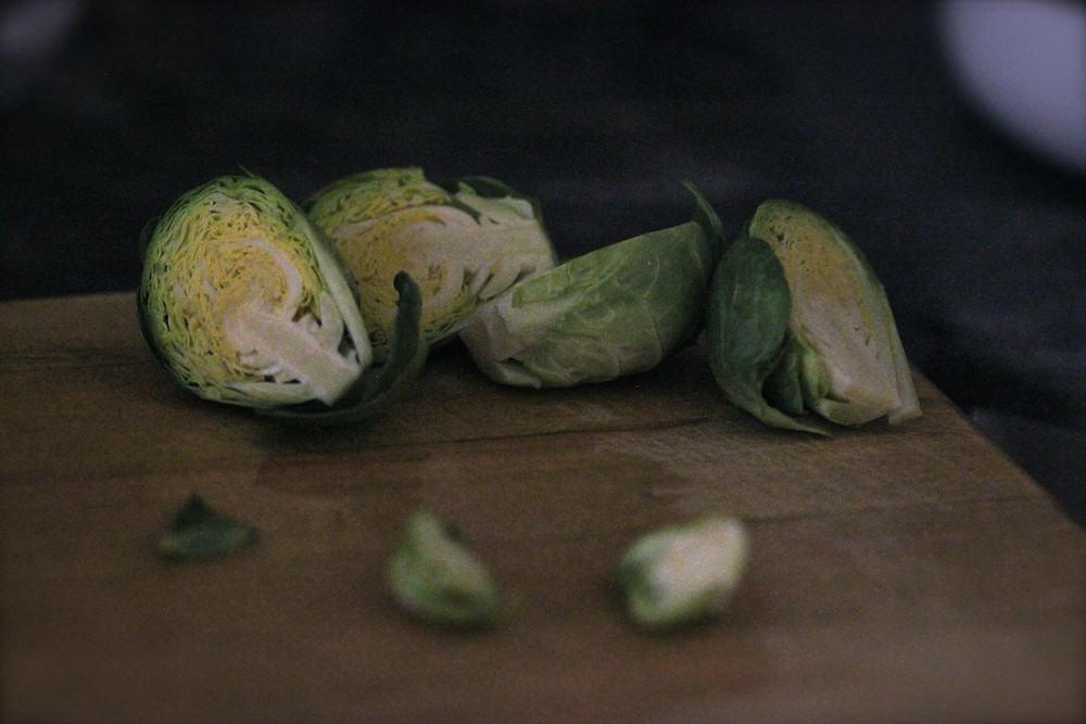Brussel sprouts on a wooden chopping board