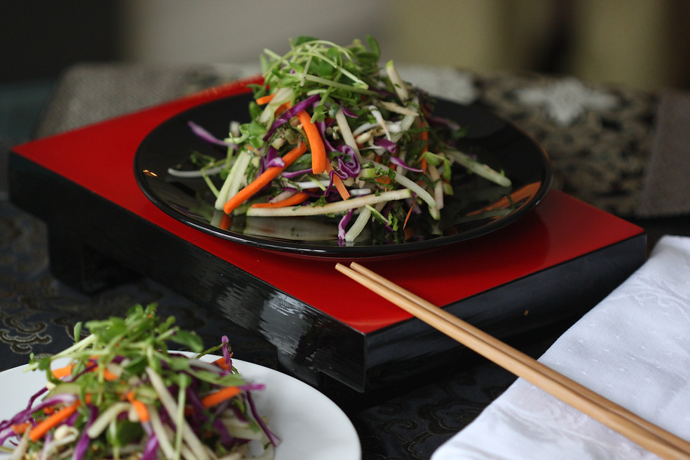 The Zen Salad perched on a red platform