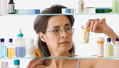 1140-woman-at-medicine-cabinet.imgcache.