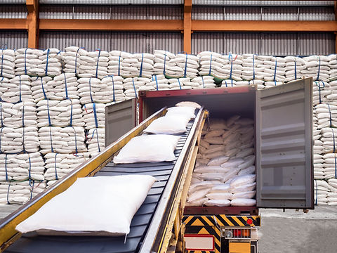 White bags of sugars from warehouse are