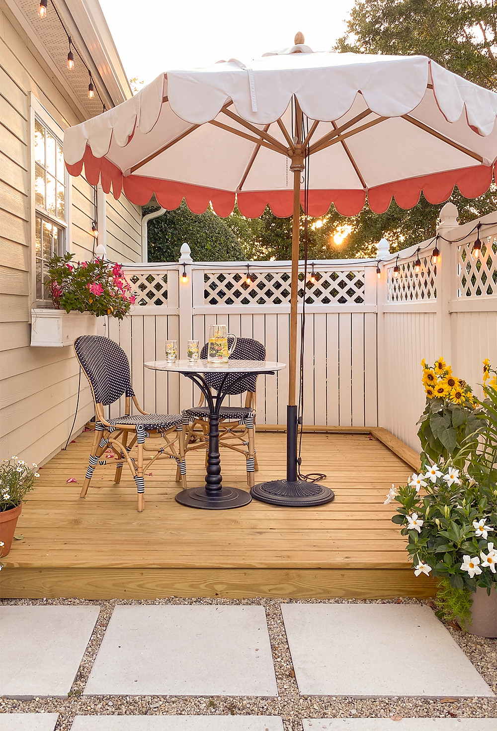 Wooden deck with a table and two chairs under an umbrella