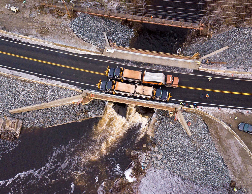 Four loaded dump trucks weighing approximately 260,000lbs, load testing the bridge outfitted with sensors.