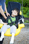 kid med CP in a special swing.jpg