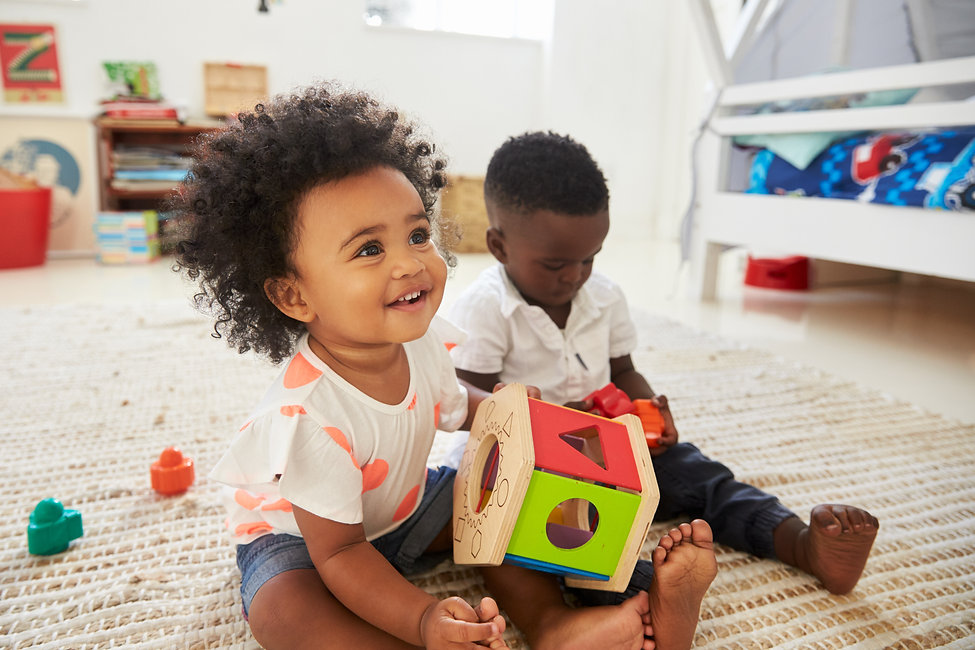 Baby Boy And Girl Playing With Toys In P