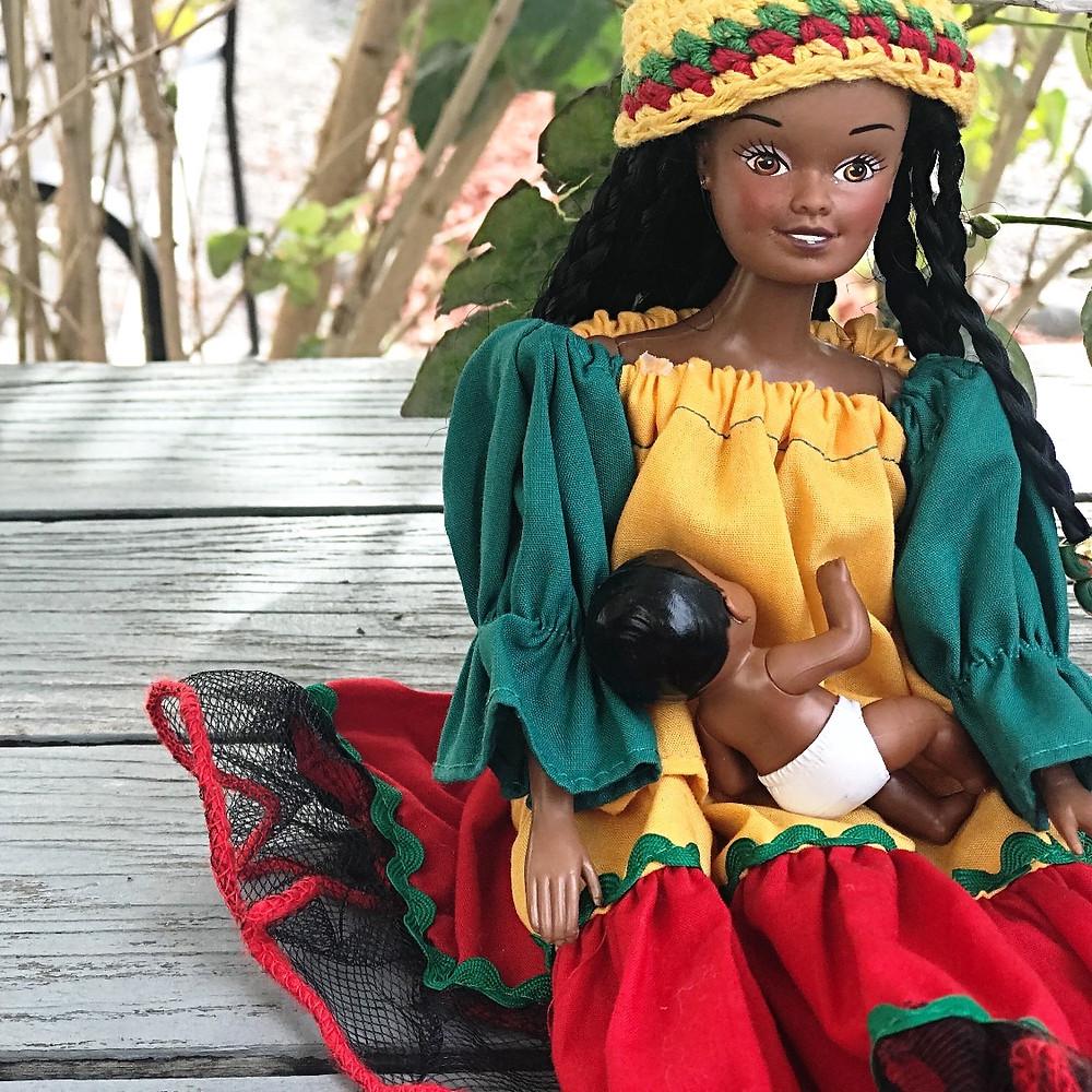 black doll breastfeeding