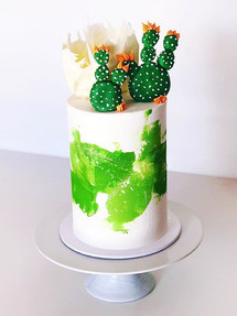 CAKE_._._Sometime less is more! 💚 _Simple, modern water color buttercream cake with white paint splatter.jpg