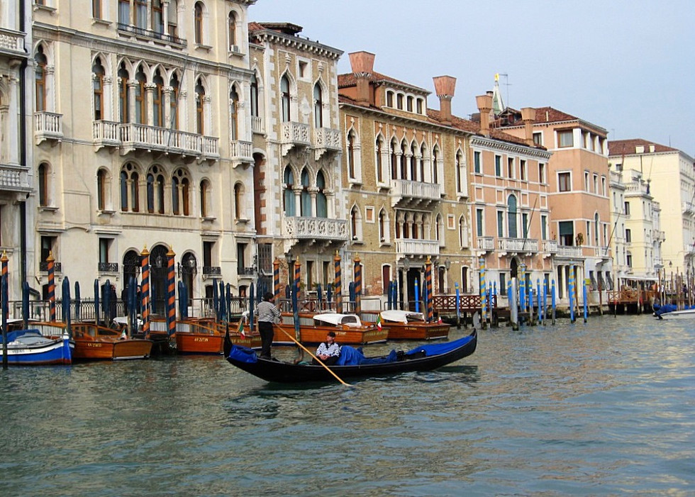 Goldoliers on the Grand Canal (Venice, Italy)