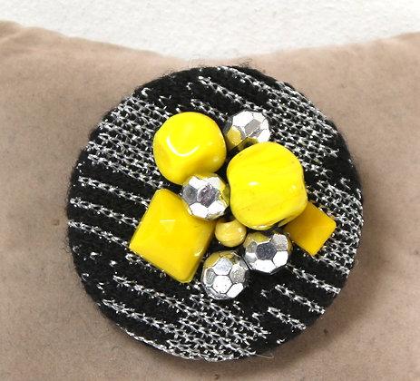 Grosse broche ronde textile et verre