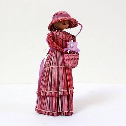 Poupée de paille rose