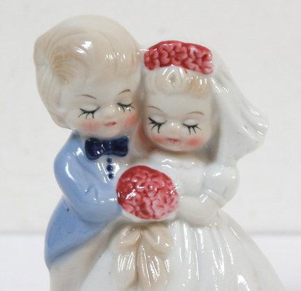 Couple de mariés vintage en porcelaine