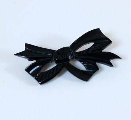 Broche noeud en bakélite noire