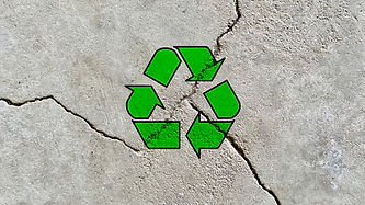 Recycling icon on a cracked cement wall, reuse waste construction materials, be environmen