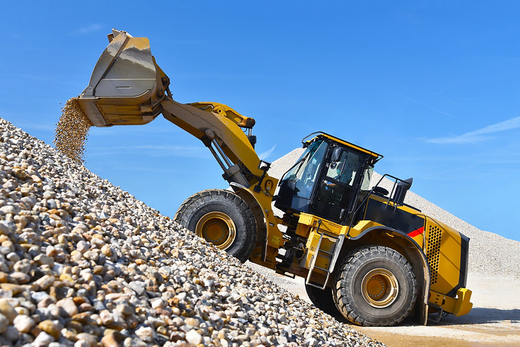 heavy construction machine in open-cast mining - wheel loader transports gravel in a grave