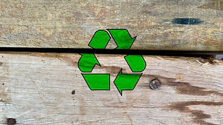 Green recycling icon on abandoned wooden boards for construction, recycle and reuse waste