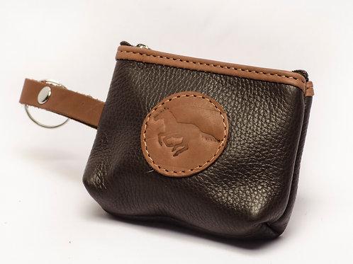 Brown coin holder. MON 03.