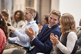 Audience Applauding Speaker After Conference Presentation.jpg