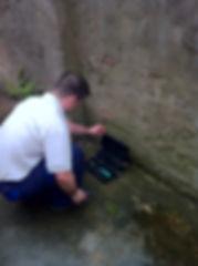 Technician checking rat box